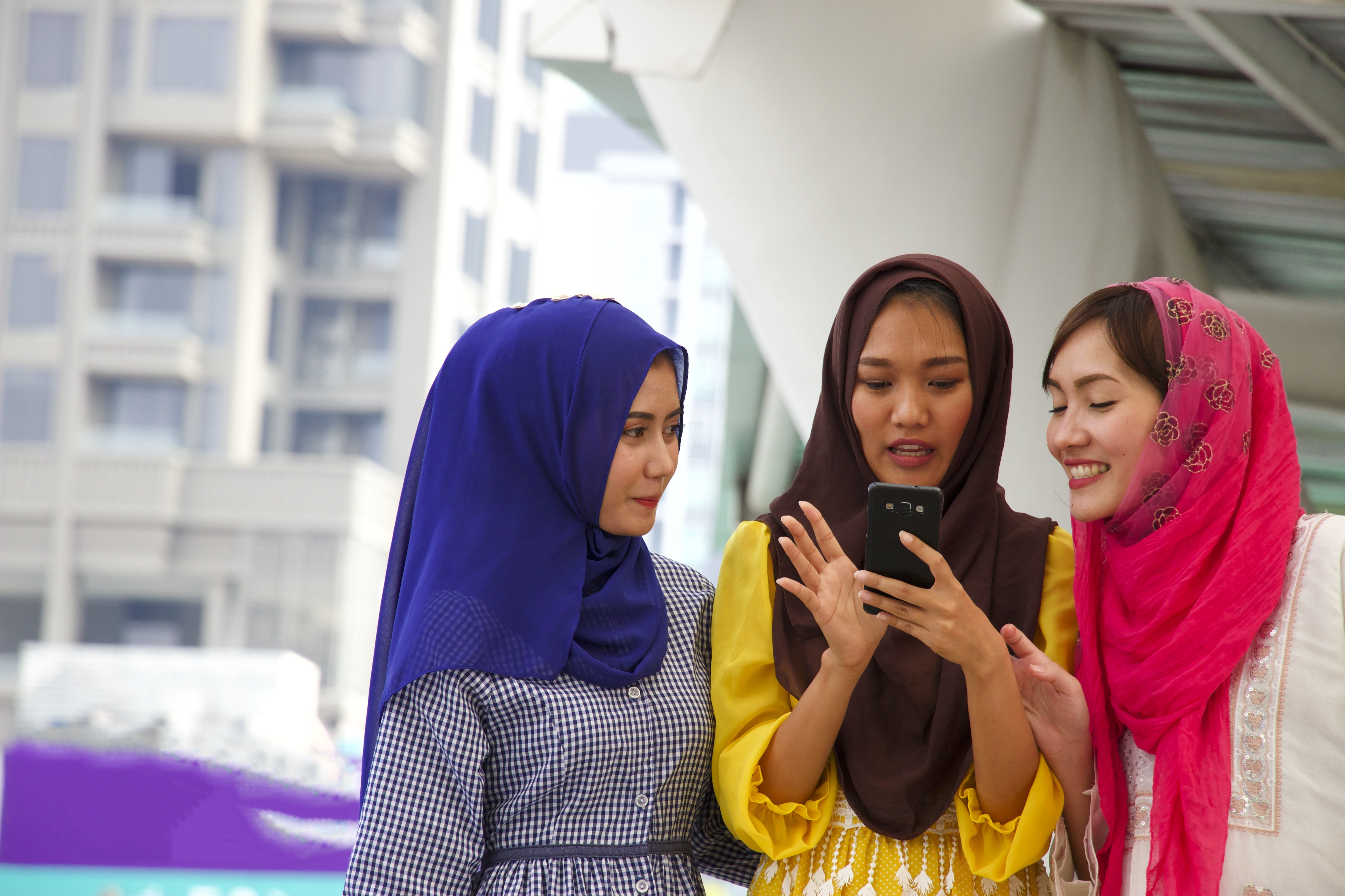 Asian-girls-looking-at-phone_shutterstock_600993269