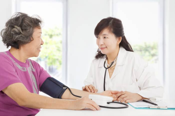 Elderly asian woman with female physician